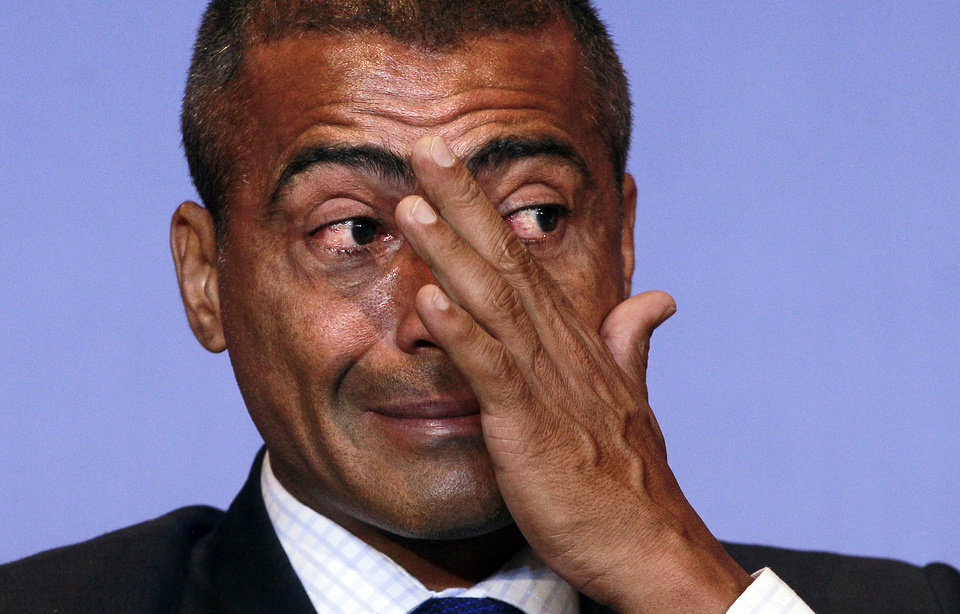 Photo - FILE - In this Dec. 23, 2011 file photo, Brazil's congressman and former soccer star Romario wipes a tear during a news conference in Rio de Janeiro, Brazil. In the latest chapter of a spat between past Brazil football greats, Ronaldo is publicly criticizing former teammate Romario for making another attack on him, this time over an alleged broken promise to provide free tickets for people with disabilities during the World Cup. (AP Photo/Victor R. Caivano, File)