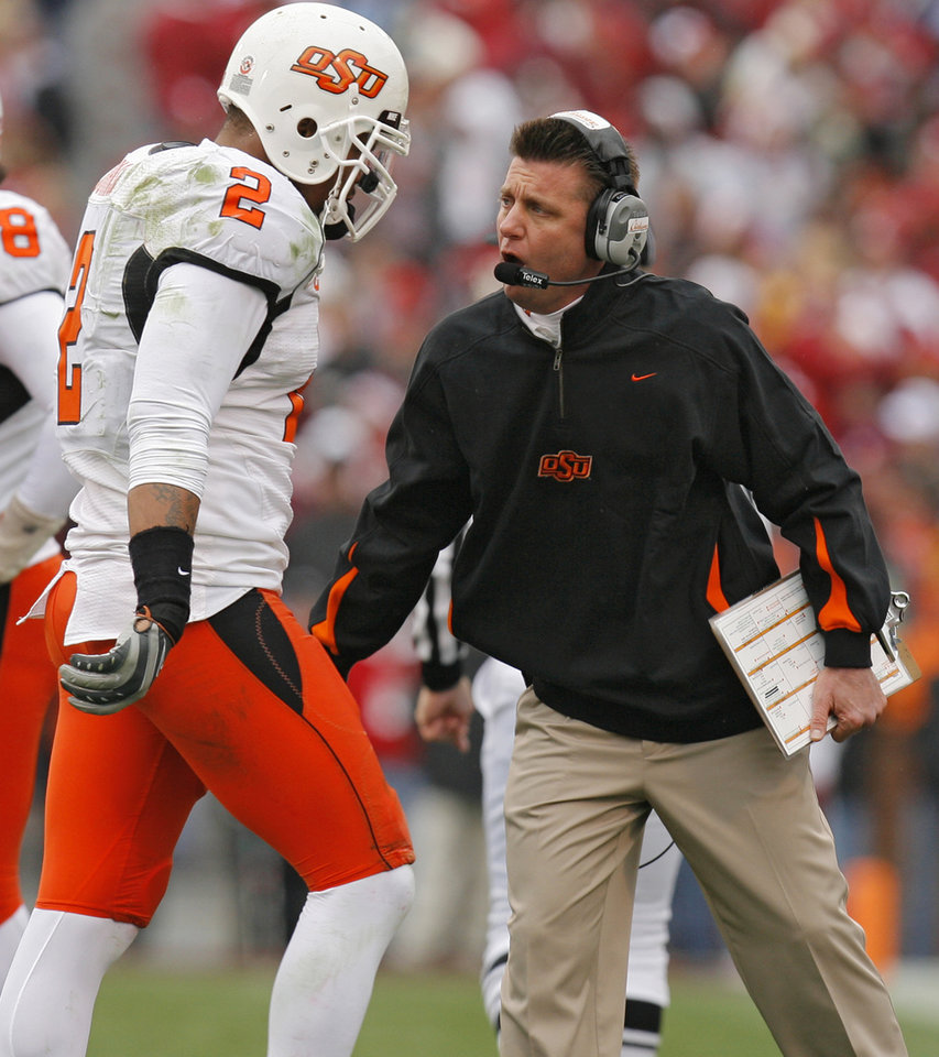 Photo - Oklahoma State coach Mike Gundy yells at Rodrick Johnson (2) during the first half of the college football game between the University of Oklahoma Sooners (OU) and the Oklahoma State University Cowboys (OSU) at the Gaylord Family-Memorial Stadium on Saturday, Nov. 24, 2007, in Norman, Okla. 
