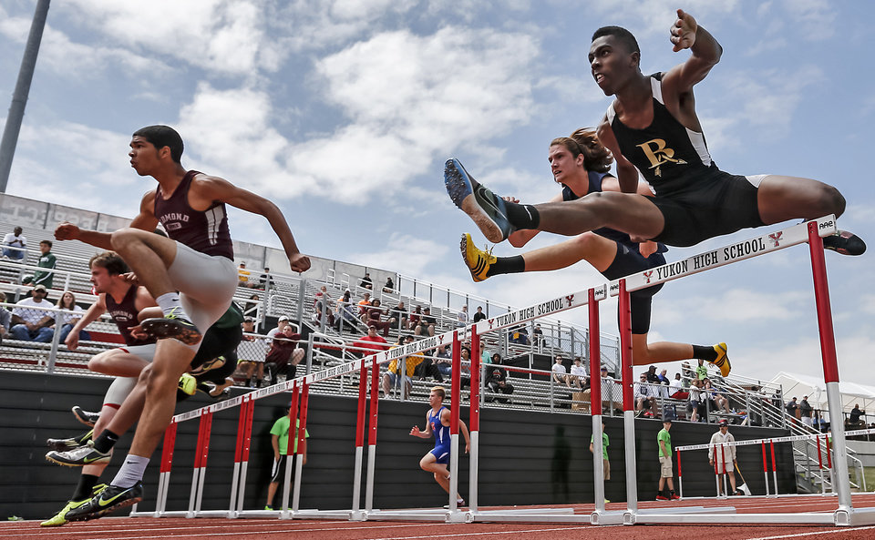 Photo - Bixby's Logan Smalley clears the hurdle in the 6A boys 110m hurdles during the class 5A and 6A track state championships at Yukon High School on on Friday, May 10, 2013, in Yukon, Okla.Photo by Chris Landsberger, The Oklahoman