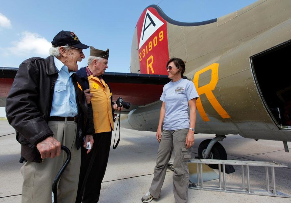 Photo -  World War II veterans Earl J. Gonzales, left, and Harley Richardson talks with flight engineer Kelly Hughes before taking a flight on a Boeing B-17 Flying Fortress as part of the Wings of Freedom Tour at Valair Aviation at Wiley Post Airport in Bethany, Okla., Friday, April 6, 2012. The Wings of Freedom Tour travels the country with vintage World War II aircraft to show the public as a living history display.Photo by Nate Billings, The Oklahoman