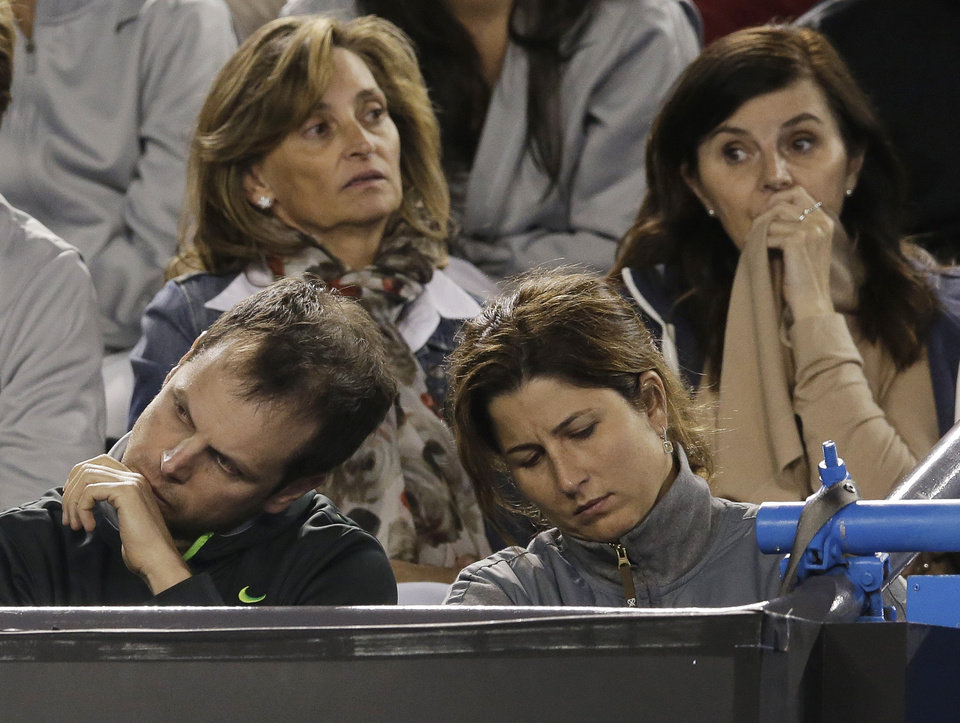 Photo - Mirka Federer reacts during the final set in the semifinal match between her husband  Roger Federer and Britain's Andy Murray at the Australian Open tennis championship in Melbourne, Australia, Friday, Jan. 25, 2013.  (AP Photo/Andy Wong)