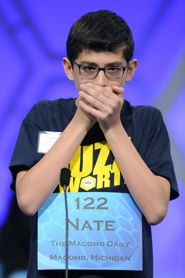 "Photo - Nathaniel Britton, 14, of Macomb, Mich.,  spells the word ""incorruptible"" during the 2105 Scripps National Spelling Bee in Oxon Hill, Md., Wednesday, May 27, 2015. (AP Photo/Cliff Owen)"