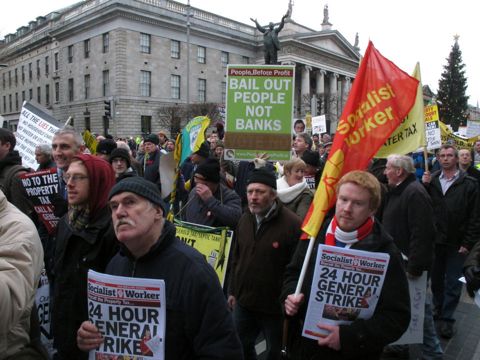 Socialist protesters march past Dublin\'s General Post Office in opposition to imminent spending cuts Saturday, Nov. 24, 2012. The government says it will unveil Ireland\'s sixth straight austerity budget next month in hopes of reducing the country\'s 2013 deficit to 8.6 percent, still nearly triple the spending limit that eurozone members are supposed to observe. (AP Photo/Shawn Pogatchnik)