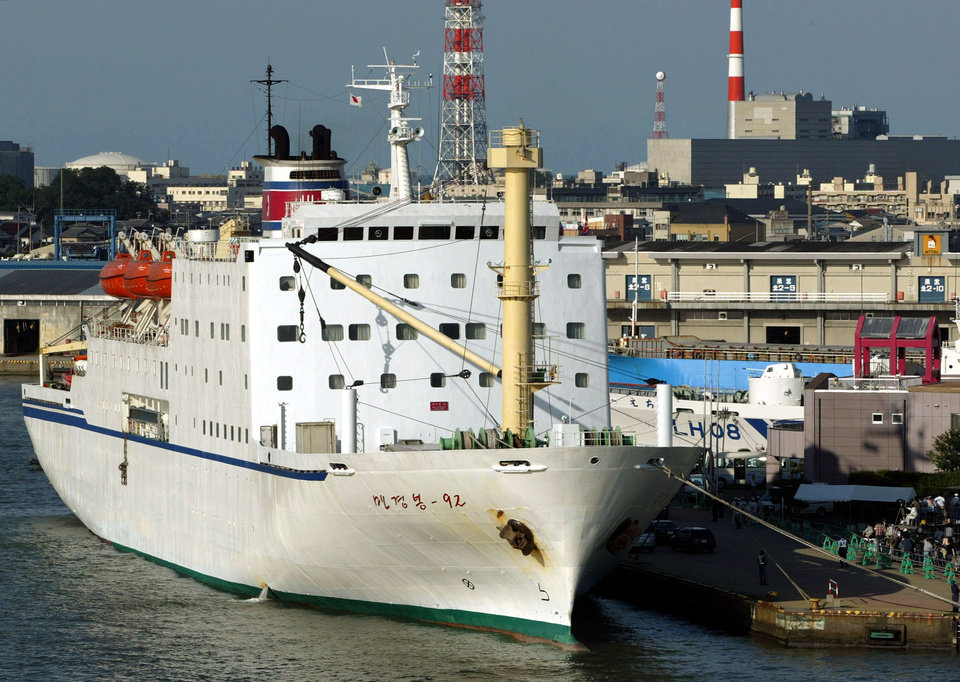 Photo - FILE - In this Thursday, Sept. 4, 2003 file photo, North Korean ferry Mangyongbong-92 is at anchor in Niigata, northern Japan. The Mangyongbong-92, a sleek white ship longer than a football field, was long the symbol of a once-massive flow of goods, people and cash between the two countries. Its recent return suggests that Pyongyang wants to resume port calls, and start pulling in Japanese cash, as soon as possible, but there has been no official explanation. Like the proverbial 500-pound gorilla in the room, Wonsan residents are reluctant to even mention it. (AP Photo/Itsuo Inouye, File)
