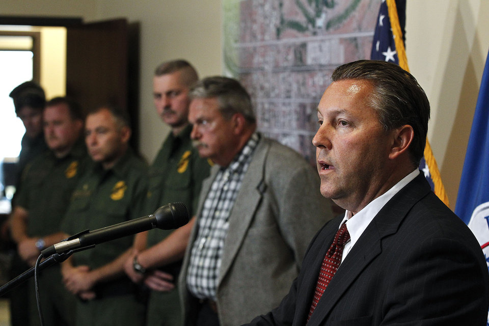 Photo -   Hours after a U.S. Border Patrol agent was shot and killed, and one other was shot and injured, from right to left, James Turgal, FBI Special Agent in Charge Phoenix, speaks, as Rodney Rothrock, Chief Deputy Cochise County Sheriffs Office, Jeffrey Self, U.S. Border Patrol Joint Field Command Arizona, Manuel Padilla, U.S. Border Patrol Acting Chief Patrol Agent Tucson Sector, and other Border Patrol Agents listen during a news conference at the U.S. Customs and Border Protection Brian A. Terry Border Patrol Station Tuesday, Oct. 2, 2012, in Bisbee, Ariz.(AP Photo/Ross D. Franklin)