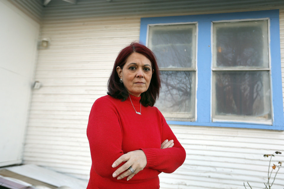 Maryam Taghavi stands outside her home Friday next to a bullet hole from a drive-by shooting in southwest Oklahoma City. Photo by Sarah Phipps, The Oklahoman <strong>SARAH PHIPPS</strong>
