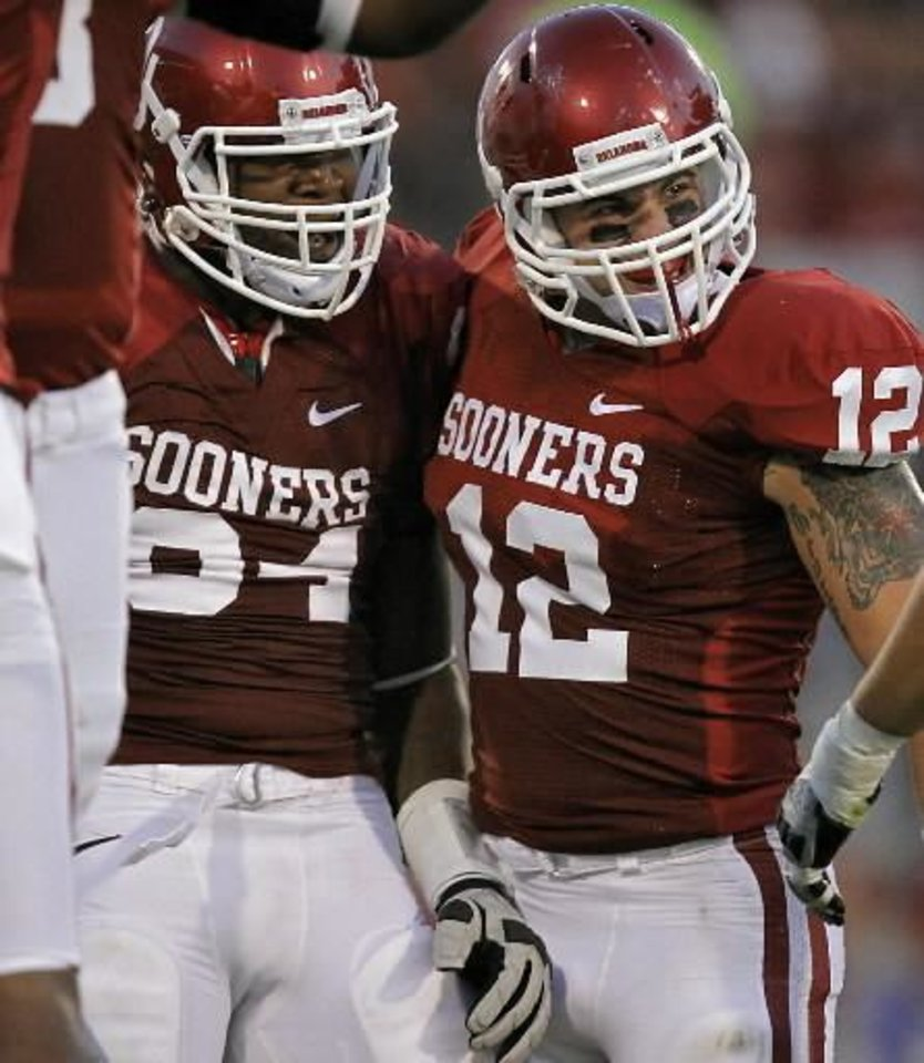 Photo - Oklahoma's Frank Alexander (84) and Tom Wort (12) celebrate after a defensive play during the college football game between the University of Oklahoma Sooners ( OU) and the Tulsa University Hurricanes (TU) at the Gaylord Family-Memorial Stadium on Saturday, Sept. 3, 2011, in Norman, Okla. Photo by Chris Landsberger, The Oklahoman ORG XMIT: KOD