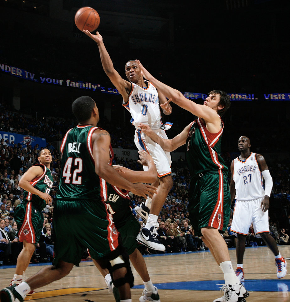 Oklahoma City's Russell Westbrook (0) moves to the hoop past Andrew Bogut (6) of the Bucks during the NBA basketball game between the Oklahoma City Thunder and the Milwaukee Bucks at the Ford Center in Oklahoma City, Wednesday, Oct. 29, 2008. This was the regular season debut of the Thunder. BY NATE BILLINGS, THE OKLAHOMAN