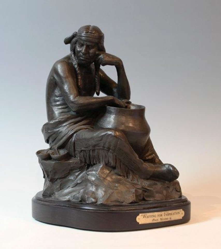 Photo - In ?Waiting for Inspiration,? priced at $3,800, sculptor Paul Moore shows an Indian potter sitting with his pot and paints and confronting every artist's classic dilemma of what to do next. PHOTO PROVIDED
