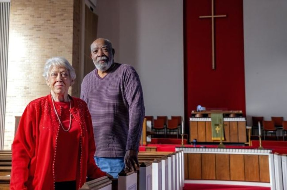 Photo -  Central Presbyterian Church elders Bobbie Heimbach and Willie Adams stand in the church's sanctuary where a final worship service will be held on Sunday at 5101 N May. The church building has been sold and is expected to be torn down. [Chris Landsberger/The Oklahoman]