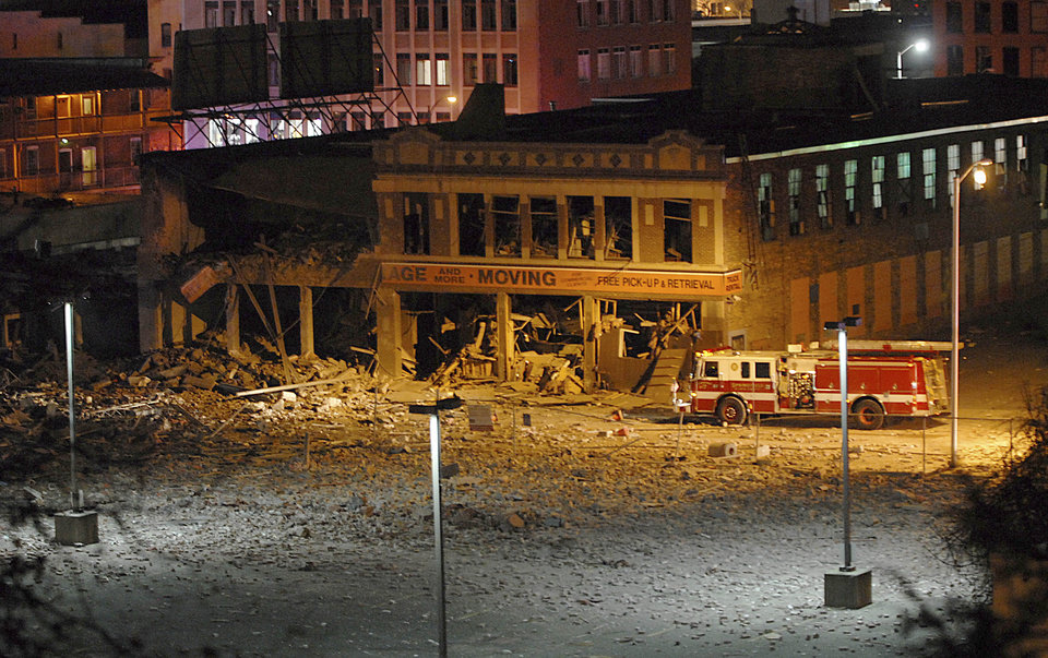 Photo -   A firetruck is parked next to a damaged building after a nearby gas explosion leveled another building in downtown Springfield, Mass. on Friday, Nov. 23, 2012. (AP Photo/Springfield Republican, David Molnar) MANDATORY CREDIT