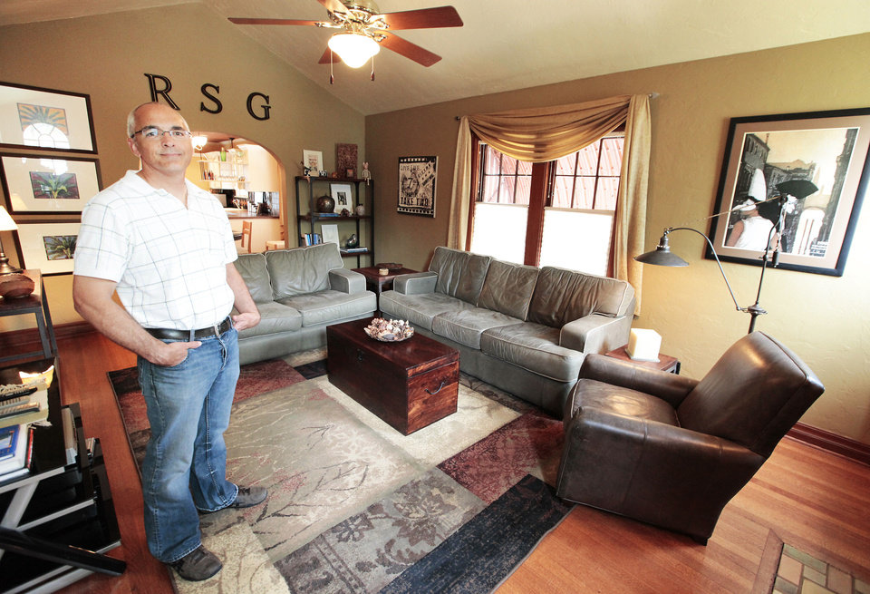 Photo - Ron Gottschalk shows the living area of his home at 2700 NW 16.  David McDaniel - The Oklahoman