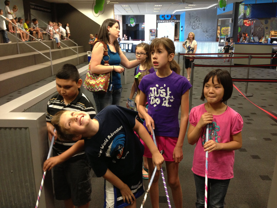 Photo -  Campers at last year's BELL camp visit the Oklahoma Science Museum. From left are Elbin, Teague, Annie and Gianna. Photo provided