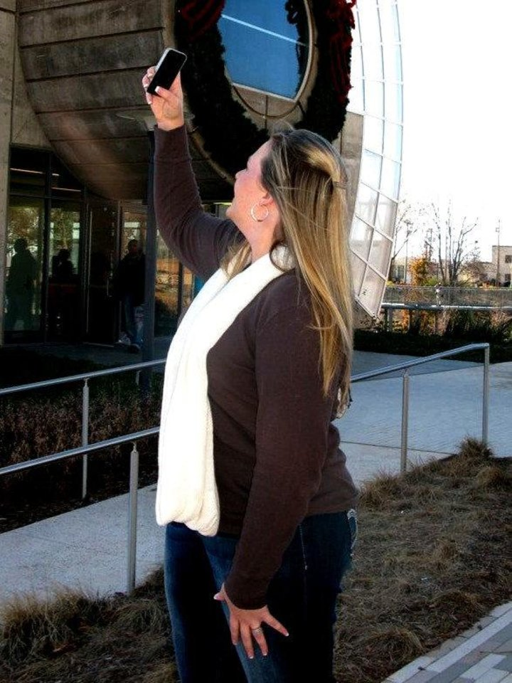 Photo - Amber Holsapple takes a photo of the Myriad Botannical Gardens during a recent meetup of Oklahoma City users of the photography application Instagram, a mobile app for the iPhone, iPod Touch or iPad. PHOTO BY LILLIE-BETH BRINKMAN, THE OKLAHOMAN