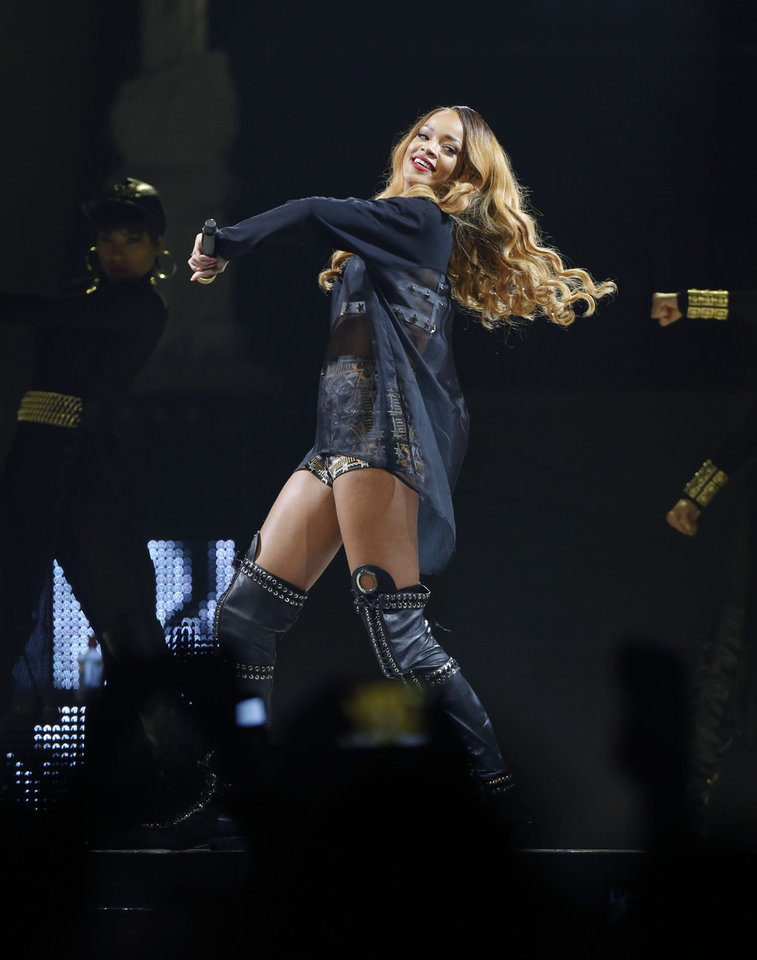Photo -  Rihanna performs in concert on Monday, May 6, 2013 in Boston. (Photo by Bizuayehu Tesfaye/Invision/AP) ORG XMIT: MABT103