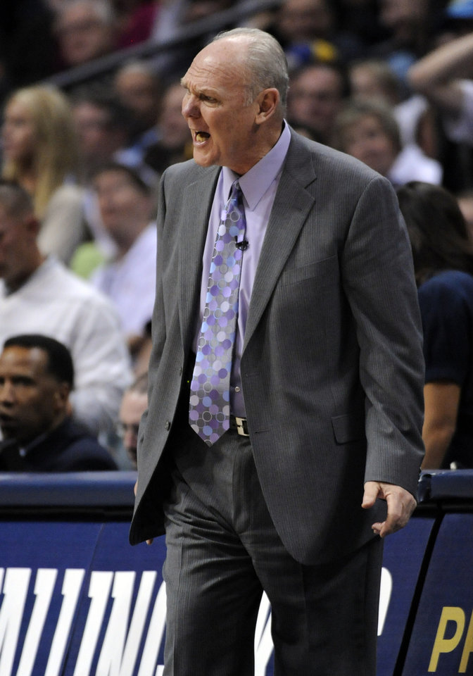Photo - Denver Nuggets head coach George Karl reacts to a call during the second half in game 4 of a first-round NBA basketball playoff series against the Oklahoma City Thunder Monday, April 25, 2011, in Denver. (AP Photo/Jack Dempsey)