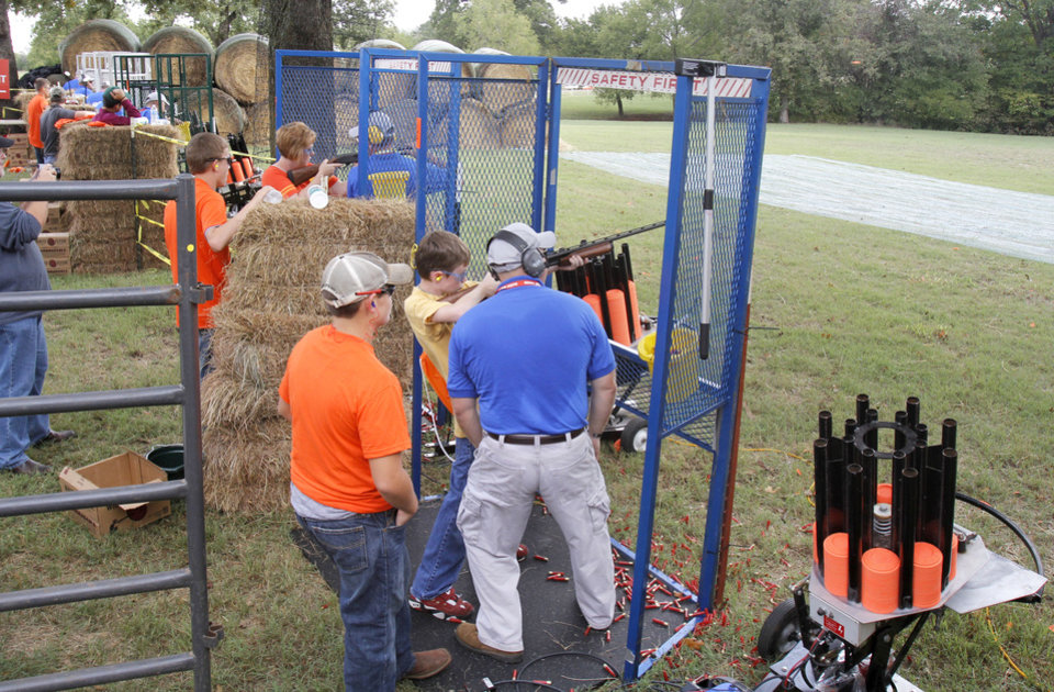 Photo - Skeet shooting is one of the activities offered to students during school day of the Oklahoma Wildlife Expo at the Lazy E Arena and Ranch in Guthrie, OK, Friday, September 28, 2012,  By Paul Hellstern, The Oklahoman
