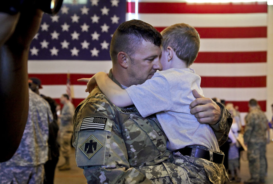 Michael Manning hugs his son Leaun as he is welcomed home during the return ceremony for the National Guard's 45th Infantry Brigade Combat Team troops at the National Guard Base on Thursday, March 15, 2012, in Oklahoma City, Oklahoma.  Photo by Chris Landsberger, The Oklahoman