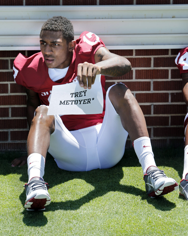 Photo - Trey Metoyer holds his ID sheet as he prepares for a photograph during photo day for the Sooners at Gaylord Family/Oklahoma Memorial Stadium at the University of Oklahoma on Saturday, Aug. 4, 2012, in Norman, Okla.  Photo by Steve Sisney, The Oklahoman