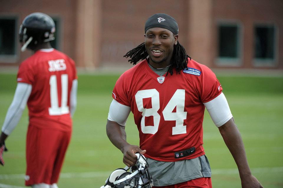 Photo - Atlanta Falcons wide receiver Roddy White (84) participates in the team's NFL football minicamp Tuesday, June 18, 2013, in Flowery Branch, Ga.   (AP Photo/David Tulis)