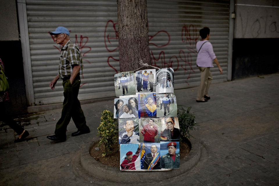 Plastic protected mages of Venezuela\'s President Hugo Chavez are displayed for sale in Caracas, Venezuela, Friday, Feb. 22, 2013. The government said that the country\'s ailing president was continuing unspecified medical treatments at the military hospital in Caracas. Chavez\'s sudden return to Venezuela after more than two months of cancer treatments in Cuba has fanned speculation that the president could be preparing to relinquish power and make way for a successor and a new election. (AP Photo/Ariana Cubillos)