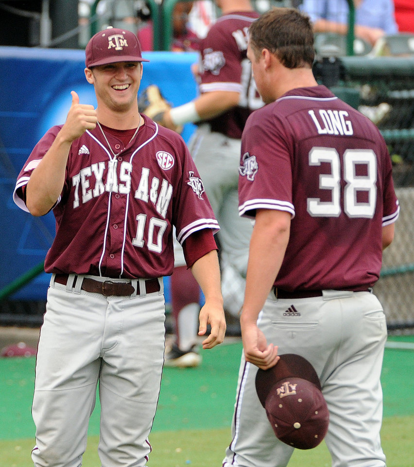 Photo - Texas A&M pitcher Grayson Long (38) gets a