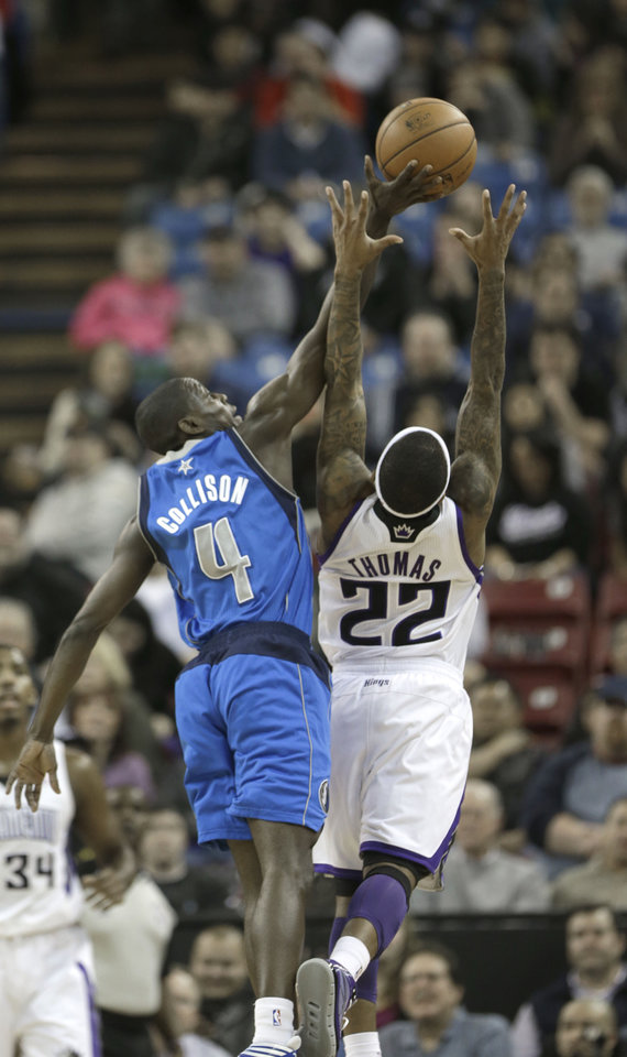 Dallas Mavericks guard Darren Collison, left, steals a pass away from Sacramento Kings guard Isaiah Thomas during the first quarter of an NBA basketball game in Sacramento, Calif., Thursday, Jan. 10, 2013. (AP Photo/Rich Pedroncelli
