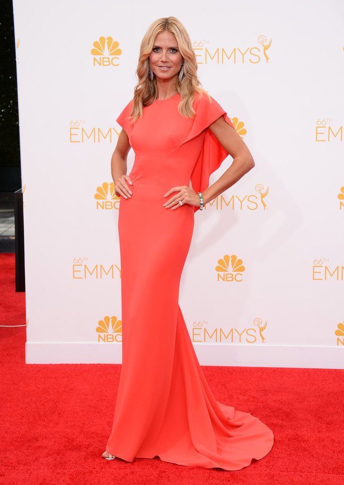 Photo - Heidi Klum arrives at the 66th Annual Primetime Emmy Awards at the Nokia Theatre L.A. Live on Monday, Aug. 25, 2014, in Los Angeles. (Photo by Jordan Strauss/Invision/AP)