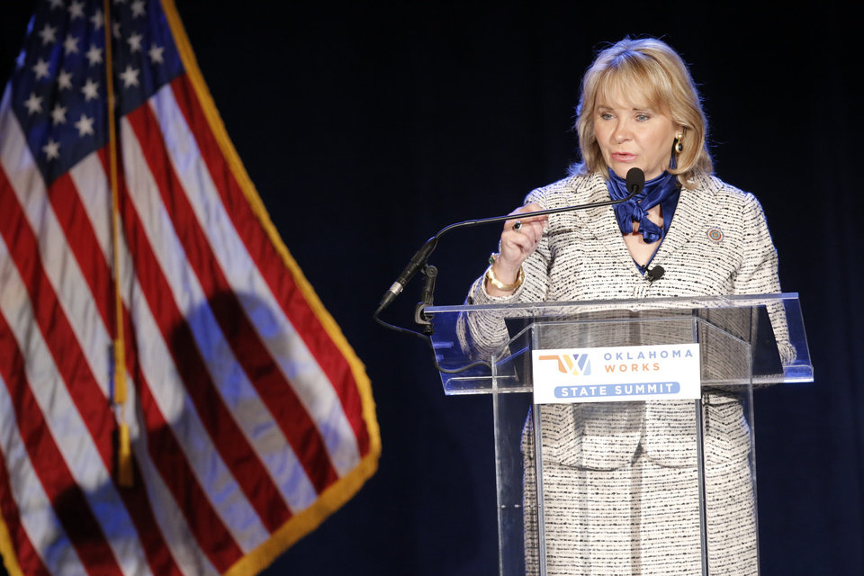 Photo -  Gov. Mary Fallin gives her presentation Thursday during the Oklahoma Works Summit at the Cox Convention Center. [Photo by Doug Hoke, The Oklahoman]