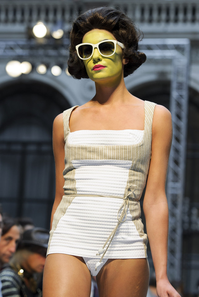 Photo -   A model wears a design from the Vivienne Westwood Red Label Spring/Summer 2013 collection during London Fashion Week, Sunday, Sept. 16, 2012. (AP Photo/Jonathan Short)