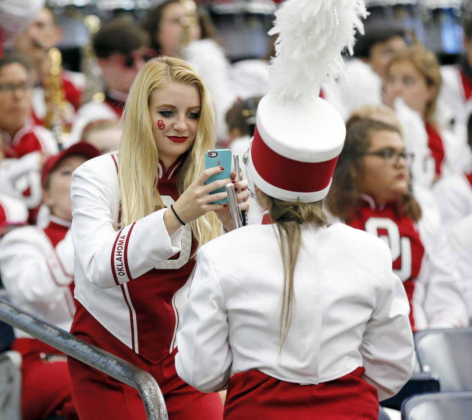 Photo - Members of the Pride of Oklahoma take a photo before the AdvoCare Texas Kickoff college football game between the University of Oklahoma Sooners (OU) and the Houston Cougars at NRG Stadium in Houston, Saturday, Sept. 3, 2016. Photo by Nate Billings, The Oklahoman