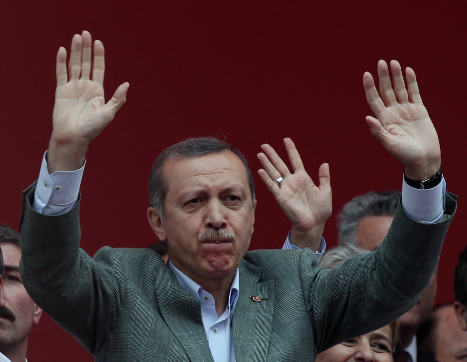 Photo - Turkish Prime Minister Recep Tayyip Erdogan salutes supporters during a party rally outside Ankara, Turkey, Saturday, June 15, 2013. Erdogan said Friday he has asked a small delegation of protesters to convince those occupying a park to withdraw, adding that he is hopeful their protest action would end soon.(AP Photo/Burhan Ozbilici)