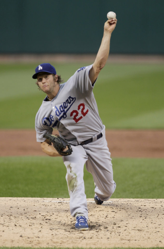 Photo - Los Angeles Dodgers starting pitcher Clayton Kershaw (22) delivers a pitch in the second inning of a baseball game against the St. Louis Cardinals, Sunday, July 20, 2014 in St. Louis.  (AP Photo/Tom Gannam)