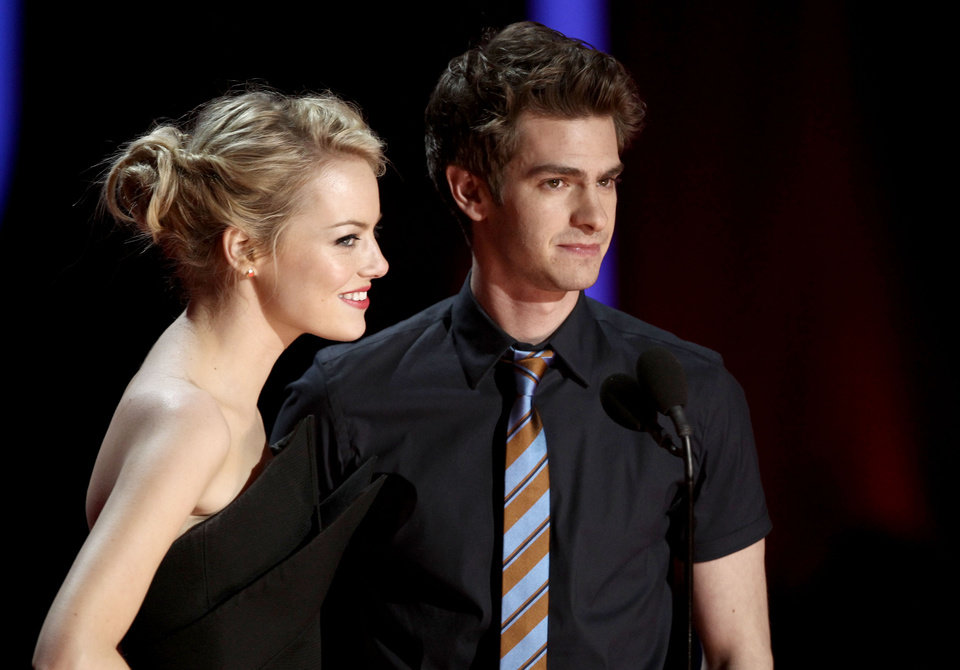 Photo -   Emma Stone, left, and Andrew Garfield are seen onstage at the MTV Movie Awards on Sunday, June 3, 2012 in Los Angeles. (Photo by Matt Sayles/Invision/AP)
