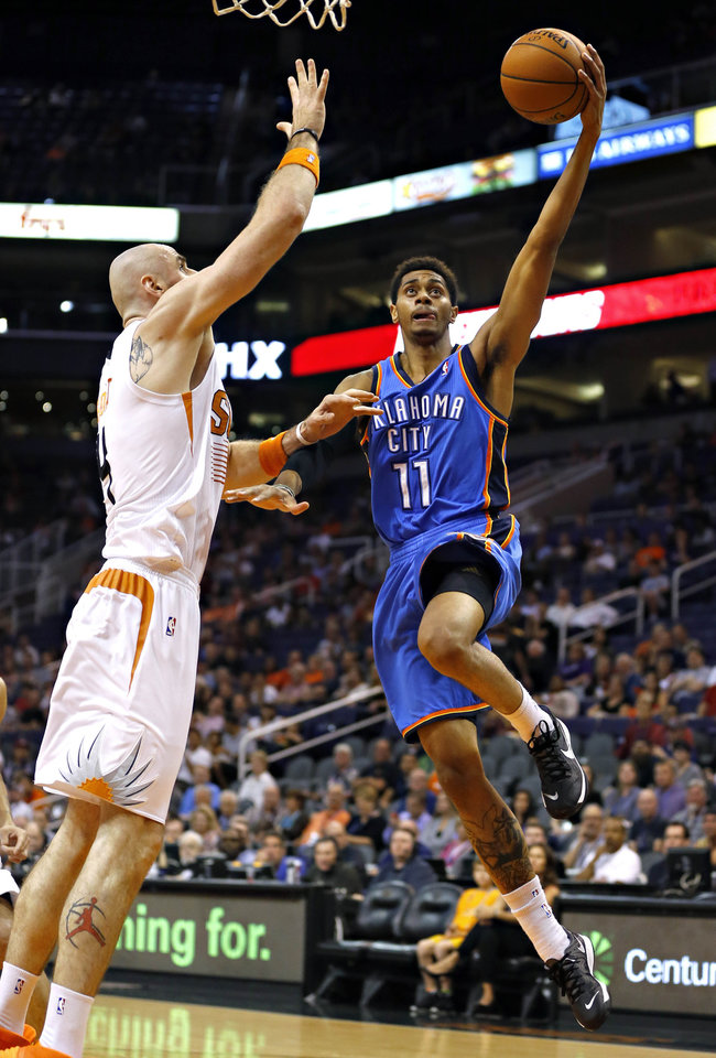 Jeremy Lamb, right, shoots over Marcin Gortat during the first half of Tuesday�s preseason game in Phoenix. AP Photo