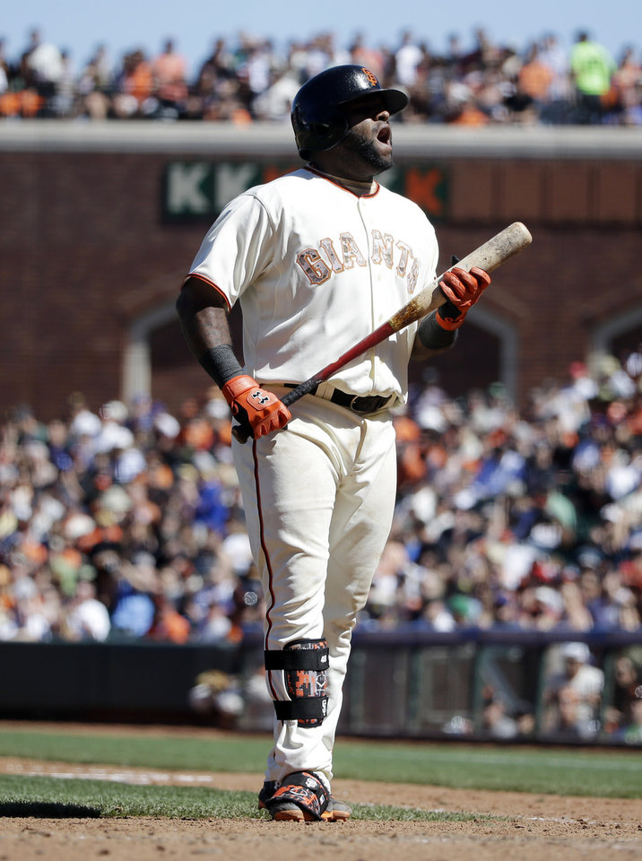 Photo - San Francisco Giants' Pablo Sandoval protests a strikeout call during the eighth inning of a baseball game against the Chicago Cubs on Monday, May 26, 2014, in San Francisco. Chicago won 8-4. (AP Photo/Marcio Jose Sanchez)