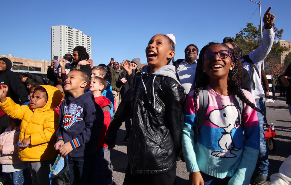 Photo - The crowd reacts to Rumble, the Thunder mascot, at the MLK Day Parade during celebration of Dr. Martin Luther King, Jr. holiday, Monday, January 20, 2019. [Photo by Doug Hoke/The Oklahoman]