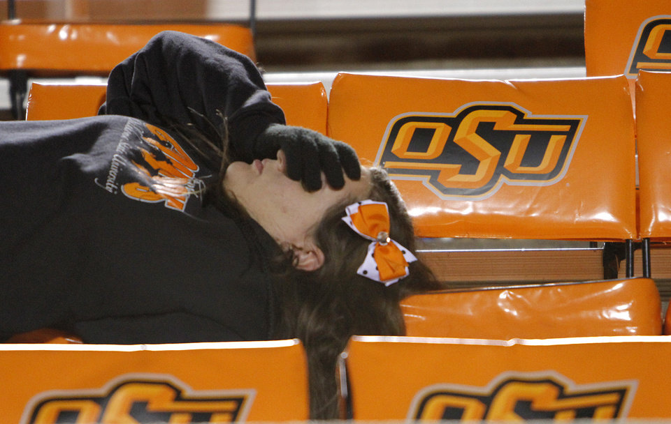 Photo - An Oklahoma State fan reacts in the stands after the 47-41 loss to Oklahoma during the Bedlam college football game between the University of Oklahoma Sooners (OU) and the Oklahoma State University Cowboys (OSU) at Boone Pickens Stadium in Stillwater, Okla., Saturday, Nov. 27, 2010. Photo by Chris Landsberger, The Oklahoman