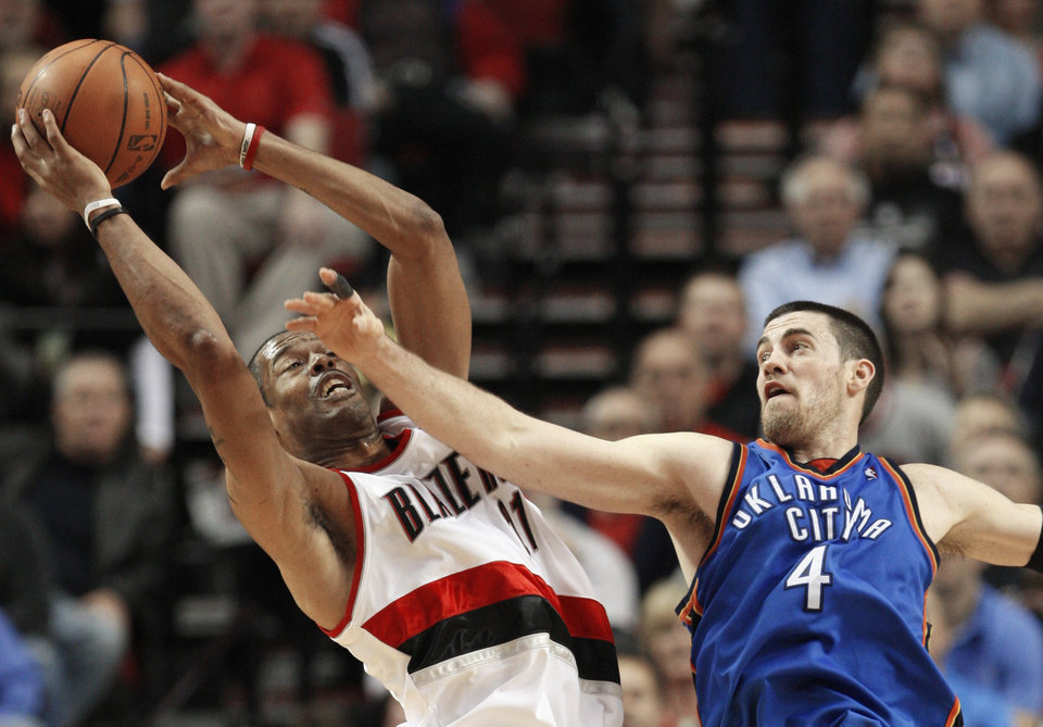Photo - Thunder forward Nick Collison defends against Portland's Marcus Camby during Oklahoma City's 103-95 loss Monday. AP PHOTO