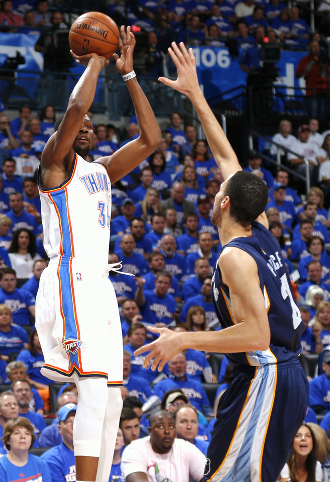 Oklahoma City's Kevin Durant shoots over Memphis' Tayshaun Prince during Game 2 in the second round of the NBA playoffs between the Oklahoma City Thunder and the Memphis Grizzlies at Chesapeake Energy Arena In Oklahoma City, Tuesday, May 7, 2013. Photo by Bryan Terry, The Oklahoman