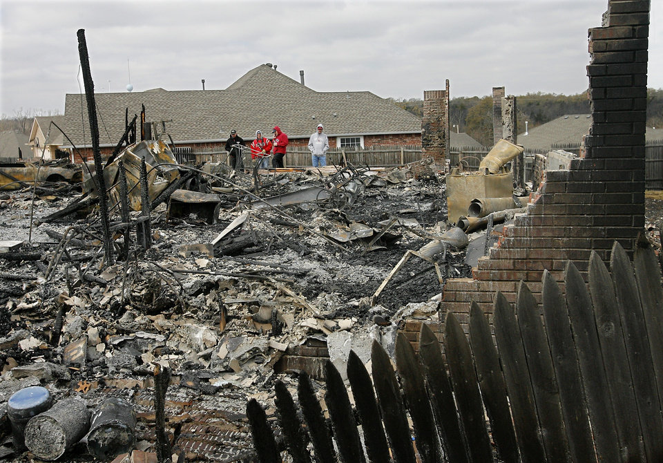 Photo - Residents  get a look at their home  that was destroyed in Thursday's wildfires in the Oakwood East Royale neighborhood in Midwest City  Friday, April 10, 2009. Photo by Jim Beckel, The Oklahoman