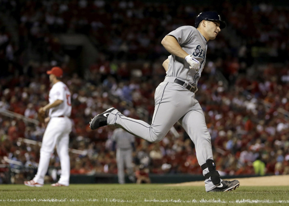 Photo - Seattle Mariners catcher Mike Zunino, right, rounds the bases after hitting a solo home run off St. Louis Cardinals starting pitcher Adam Wainwright during the fifth inning of a baseball game Friday, Sept. 13, 2013, in St. Louis. (AP Photo/Jeff Roberson)