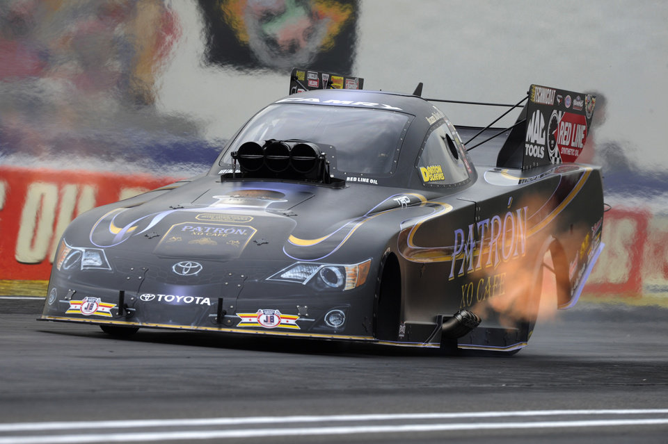 Photo - In this photo provided by NHRA, Alexis DeJoria races her Funny Car to victory Monday, Sespt. 1, 2014,  at the 60th annual Chevrolet Performance U.S. Nationals at Lucas Oil Raceway in Brownsburg, Ind.  DeJoria powered her Patron XO Café Toyota Camry to a winning run of 4.038 seconds at 310.34 mph to defeat current NHRA Mello Yello Drag Racing Series Funny Car points leader John Force in the final round.    (AP Photo/ Jerry Foss)