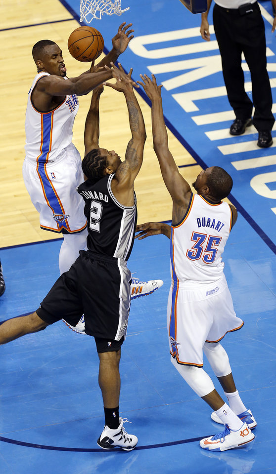 Photo - Oklahoma City's Kevin Durant (35) and Serge Ibaka (9) defend against San Antonio's Kawhi Leonard (2) during Game 3 of the Western Conference Finals in the NBA playoffs between the Oklahoma City Thunder and the San Antonio Spurs at Chesapeake Energy Arena in Oklahoma City, Sunday, May 25, 2014. Photo by Nate Billings, The Oklahoman