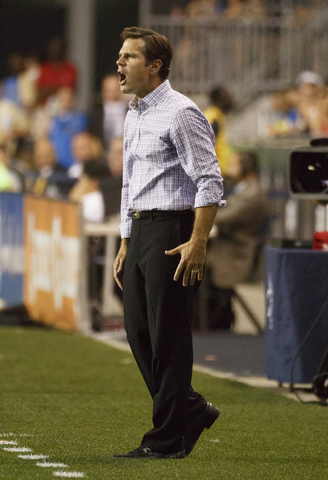 Photo - Toronto FC's head coach Greg Vanney calls out from the sideline during the first half of an MLS soccer match against the Philadelphia Union, Wednesday, Sept. 3, 2014, in Chester, Pa. (AP Photo/Chris Szagola)