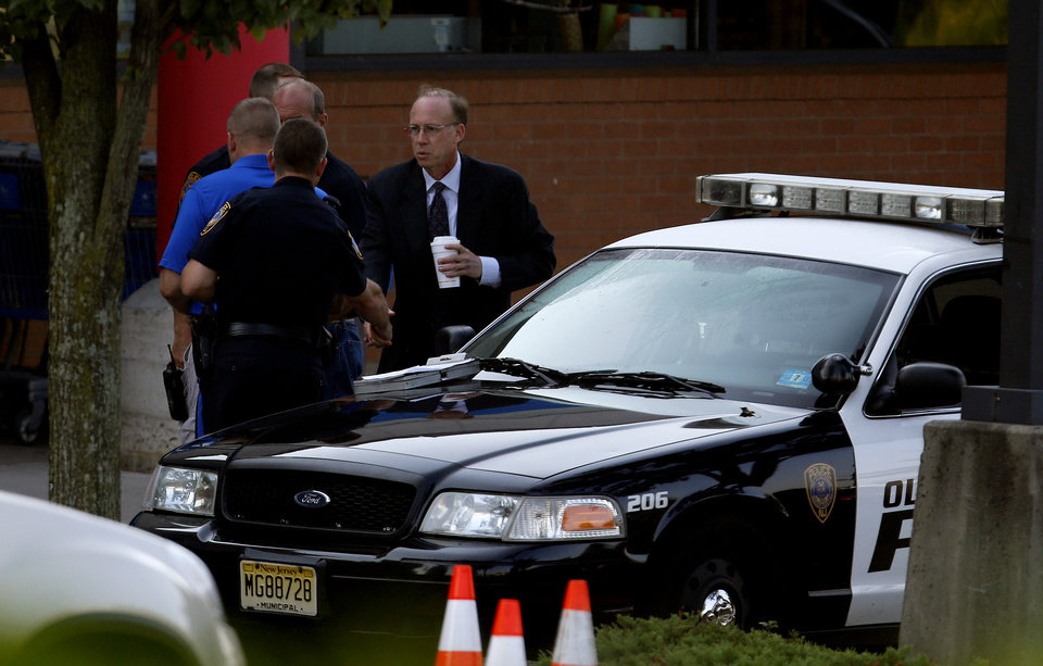 Photo -   Middlesex County prosecutor Bruce Kaplan, right, arrives at the scene of a shooting at a Pathmark grocery store in Old Bridge, N.J., Friday, Aug. 31, 2012. At least three people have died in the shooting. A law enforcement official briefed on the shooting says the person believed to be the shooter is among the dead. (AP Photo/Julio Cortez)