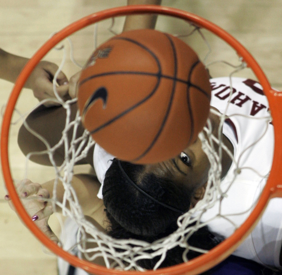 Photo - Oklahoma's Courtney Paris watches one of her baskets in the first half of a women's college basketball game against Kansas State in Norman, Okla., Wednesday, Jan. 3, 2007. Oklahoma won the game 78-58. Paris had 18 points in the victory. (AP Photo/Sue Ogrocki) ORG XMIT: OKSO105