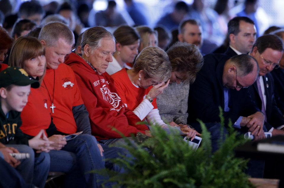 Photo - Persons in attendance at a memorial service bow their head in prayer, Thursday, April 17, 2014, in West, Texas, honoring those killed in a fertilizer plant explosion one year ago.  (AP Photo/Tony Gutierrez)