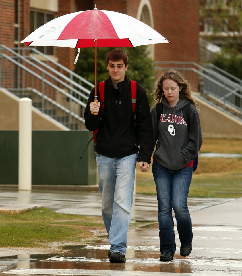 Students David Barron and Rebecka Bruhn walk past buildings on the campus of the University of Oklahoma on Tuesday, April 2, 2013 in Norman, Okla. Photo by Steve Sisney, The Oklahoman