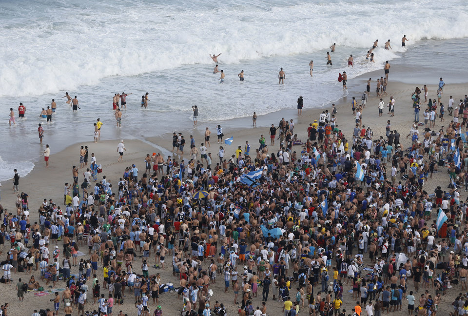 Photo - Soccer fans of the Argentina's national soccer team sing and dance on Copacabana beach, in Rio de Janeiro, Brazil, Saturday, July 12, 2014. Argentina will face Germany in the World Cup final, Sunday. (AP Photo/Silvia Izquierdo)